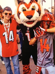 A family photo of Jason Pittman, 25 left, while attending a Bengals game. His family said he was a die-hard fan.