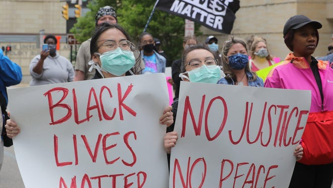 Protesters gather in front of the Akron Police Department to rally against police violence and the death of George Floyd on Saturday, May 30, 2020  in Akron, Ohio.
