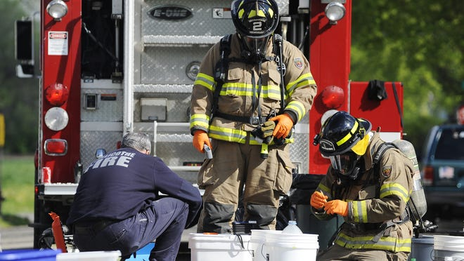 Firefighters work on neutralizing some of the one-pot labs found in during an April 2014 raid on a house on North Rose Street. The find was the fifth for that month and part of what prompted the Chillicothe City Council to look into meth lab cleanup legislation, which passed later.