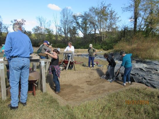 Swannanoa Valley Museum docents take turns digging