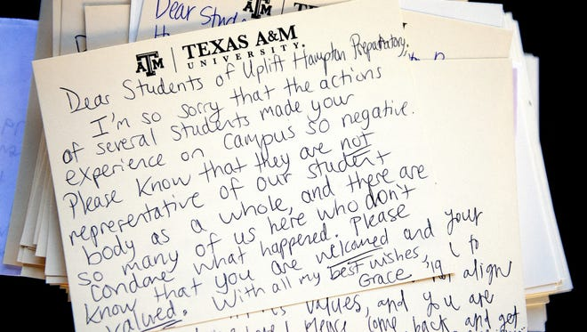 This Monday, Feb. 15, 2016, photo shows a letter addressed to visiting students from Uplift Hampton Preparatory sits atop a stack of similar notes at Texas A&M University in College Station, Texas. Texas A&M University System Chancellor John Sharp apologized Tuesday to high school students for racial insults that some minority students say they heard while visiting the College Station campus last week. (Dave McDermand/College Station Eagle via AP) MANDATORY CREDIT  ORG XMIT: TXBRY201