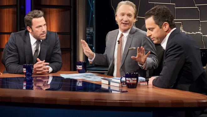 """Host Bill Maher, center, talks with actor Ben Affleck, left, and Sam Harris, author of """"Waking Up: A Guide to Spirituality Without Religion"""", during """"Real Time With Bill Maher,"""" in Los Angeles."""