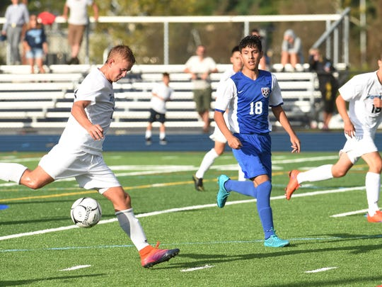 John Jay's Matt Howe, left, winds up a kick during Thursday's game against Carmel.