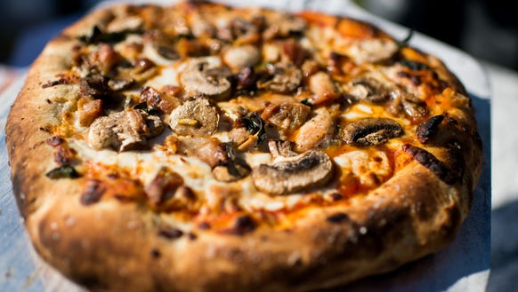 A freshly-baked smoked chicken and mushroom pizza,