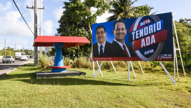 A campaign sign for the Republican gubernatorial team of Lt. Gov. Ray Tenorio and Sen. Tony Ada can be seen posted along Marine Corp Drive in Yigo on Thursday, Jan. 18, 2018.