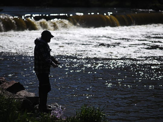 Kevin Johnson, of Sioux Falls, fishes from the shores of the Big Sioux River Thursday, April 21, 2016, at Baltic River Park in Baltic, S.D.