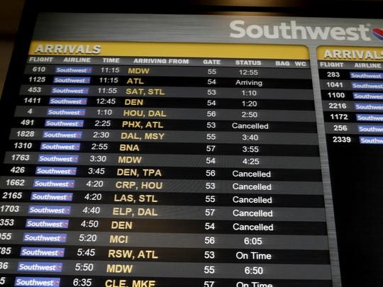"Cancelled flights are seen on an arrivals board at the Southwest Airlines ticketing area at LaGuardia Airport, Friday, Jan. 25, 2019, in New York. The Federal Aviation Administration reported delays in air travel Friday because of a ""slight increase in sick leave"" at two East Coast air traffic control facilities. (AP Photo/Julio Cortez)"