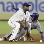 Kansas City Royals' Paulo Orlando, right, steals second base against Texas Rangers shortstop Elvis Andrus during the seventh inning Thursday in Arlington, Texas.