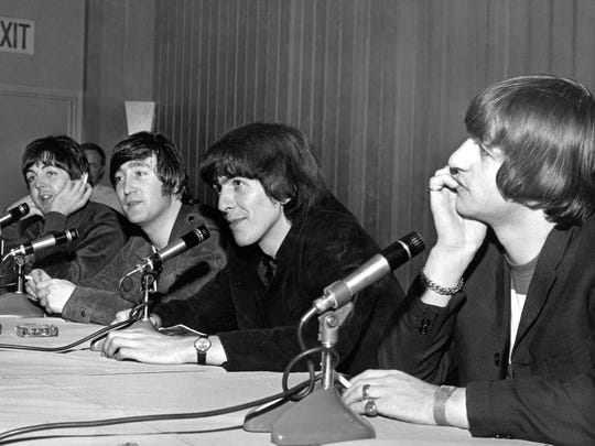 Paul McCartney, left to right, John Lennon, George Harrison and Ringo Starr during a press conference on Aug. 22, 1965, at Memorial Coliseum in Portland.