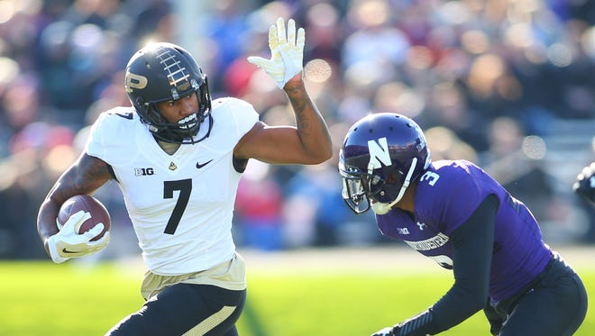 Nov 14, 2015; Evanston, IL, USA; Purdue Boilermakers wide receiver DeAngelo Yancey (7) runs the ball while Northwestern Wildcats cornerback Keith Watkins II (3) defends during the first half at Ryan Field. Mandatory Credit: Caylor Arnold-USA TODAY Sports