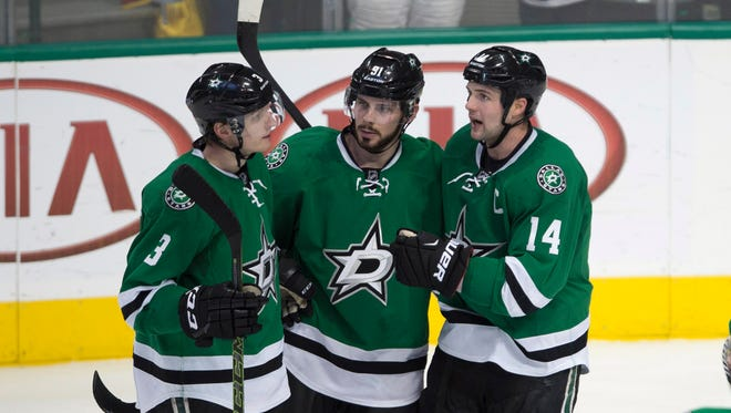 Dallas Stars defenseman John Klingberg (3) and center Tyler Seguin (91) and left wing Jamie Benn (14) celebrate Seguin's second goal against the Washington Capitals during the second period at the American Airlines Center.