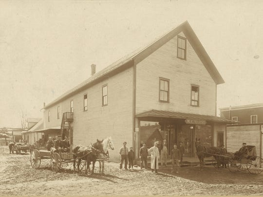 This building constructed by George Maynard in 1884, known as the Marsh Store, replaced the Wead & Hapgood Store on the corner of Bridge Street and Depot Street. Together Marsh and Maynard turned it into one of the largest general stores in northern Vermont.