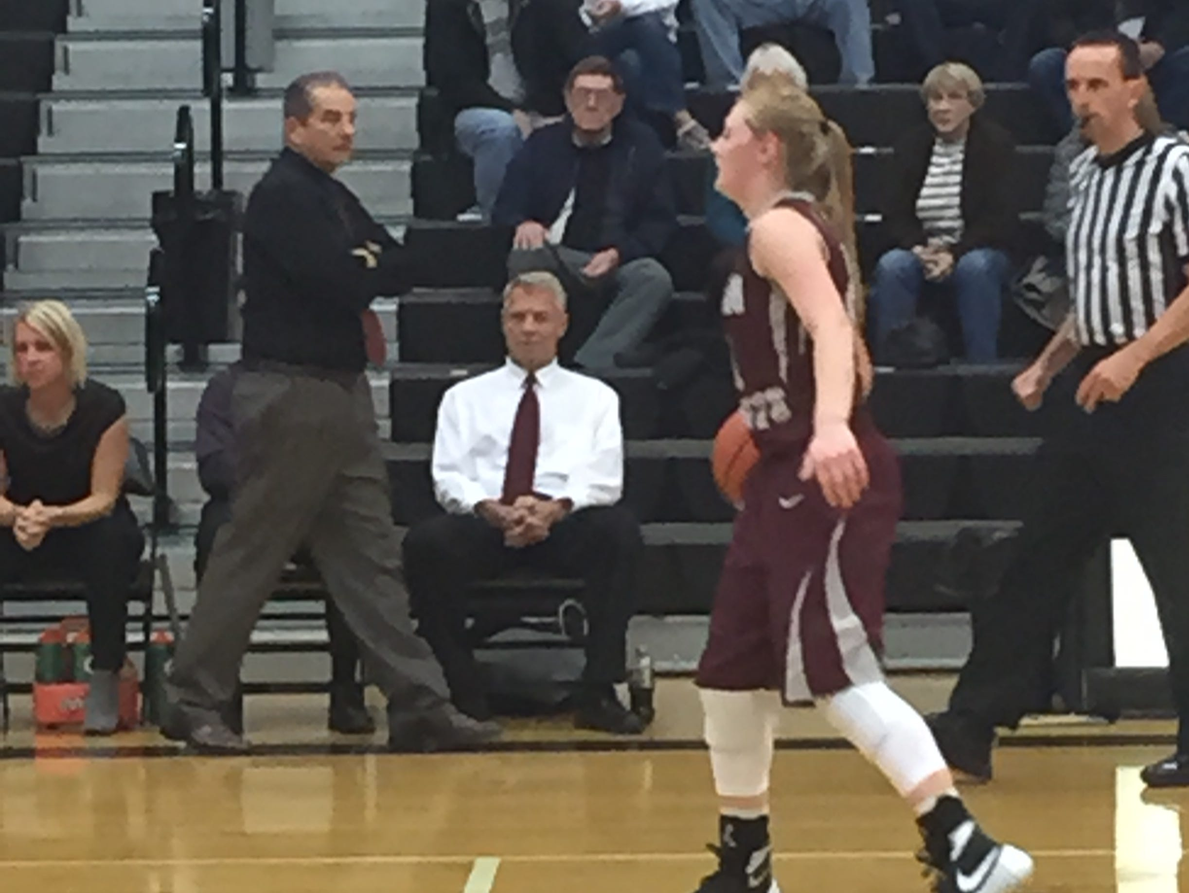 Genoa's Haley Pickard handles the ball as coach Mike DeStazio walks the sideline Friday during an NBC victory over Otsego.