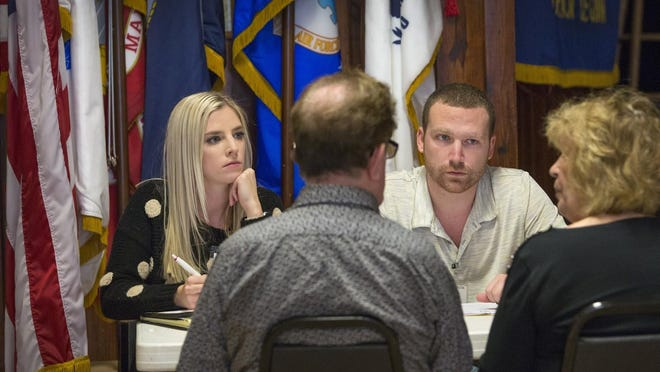College of Law students at Lake Ella American Legion Chandler McCoy , left, and Joe Harrington consult with clients.
