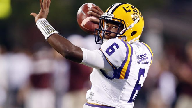 LSU quarterback Brandon Harris (6) throws a pass during warmups Saturday before the game against Mississippi State at Davis Wade Stadium in Starkville, Miss.