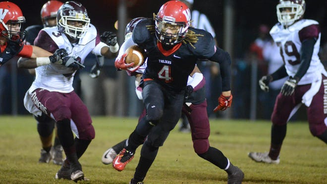 West Marion's Money Gaddis carries the ball upfield Friday night during the Trojans' game against Hazlehurst in Columbia.
