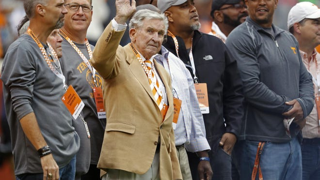Former Tennessee football coach Johnny Majors waves to fans as he and members of the 1998 football team are introduced in the first half of an Oct. 12, 2019 game against Mississippi State in Knoxville, Tenn.