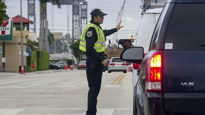 Palm Beach Sheriff's Office personnel monitor traffic on Southern Boulevard during President Trump's stay at Mar-a-Lago in December.