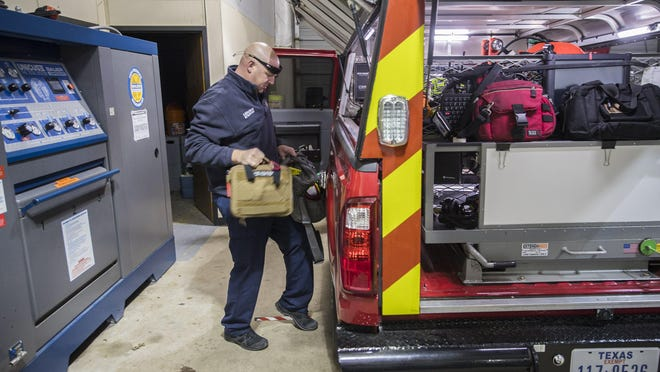 Battalion Chief Mark Moellenberg of Pflugerville Fire Department prepares his gear on Jan. 10, 2019. The Fire Department has spent more than $200,000 in extra expenses due to the coronavirus pandemic, officials say.