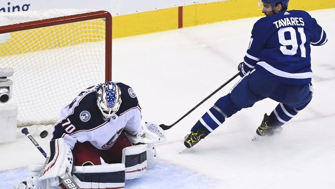 Maple Leafs center John Tavares scores past Blue Jackets goaltender Joonas Korpisalo on a breakaway in the third period of Game 2 on Tuesday.