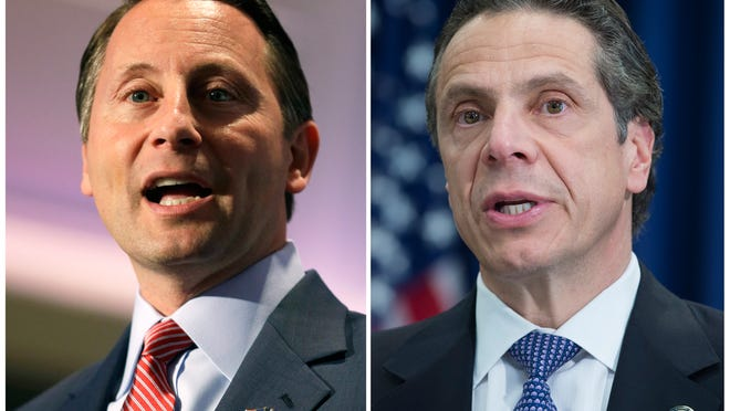 FILE- In this combination of two file photos, Westchester County executive Rob Astorino, left, New York Governor Andrew Cuomo are shown. Republican Astorino will challenge the Democratic incumbent Cuomo for the New York Governorship in November 2014. (AP Photo)