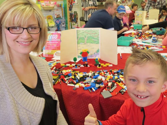 Hammonton residents Andrea Michaelis and her son, Logan, give the Lego March Madness event a big thumbs up.