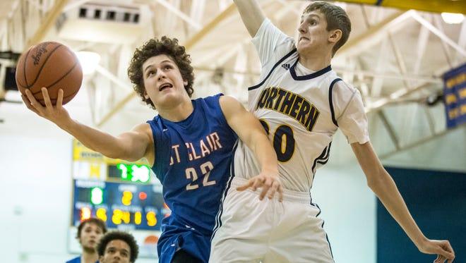 St. Clair junior Ben Davidson goes for a shot on Port Huron Northern junior Cam Hicks during a basketball game Thursday, Jan. 5, 2017 at Port Huron Northern High School.