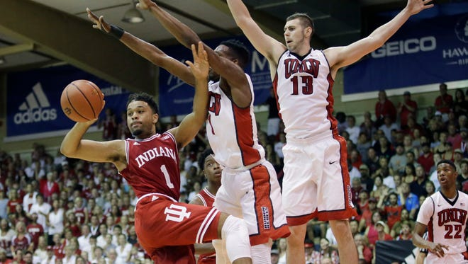 Indiana guard James Blackmon Jr. (1) passes the ball as UNLV's Derrick Jones Jr. (1) and Ben Carter (13) defend in the first half during an NCAA college basketball game in the Maui Invitational Wednesday, Nov. 25, 2015, in Lahaina, Hawaii. (AP Photo/Rick Bowmer)