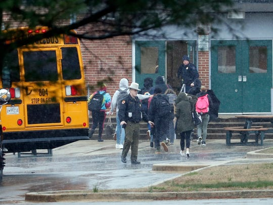 Police move students into a different area of Great Mills High School, the scene of a shooting, Tuesday morning, March 20, 2018 in Great Mills, Md.