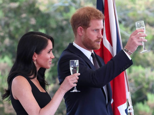 Prince Harry and Duchess Meghan of Sussex raise glasses