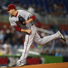 Arizona Diamondbacks starter Trevor Hill pitches to the Miami Marlins on Aug. 15, 2014.