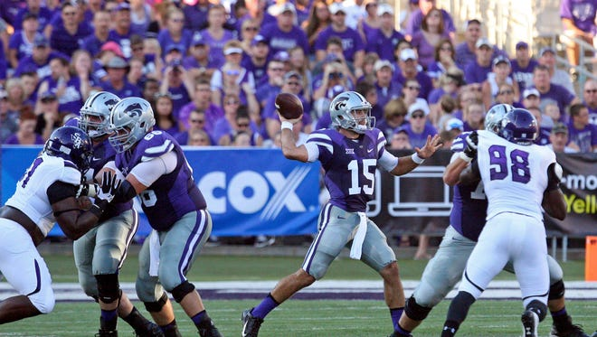 Aug 30, 2014; Manhattan, KS, USA; Kansas State Wildcats quarterback Jake Waters (15) drops back to pass during first-quarter action against the Stephen F. Austin Lumberjacks at Bill Snyder Family Stadium. Mandatory Credit: Scott Sewell-USA TODAY Sports