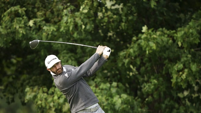 Dustin Johnson tees off during practice before the U.S. Open Championship golf tournament at Winged Foot Golf Club on Tuesday in Mamaroneck, N.Y.