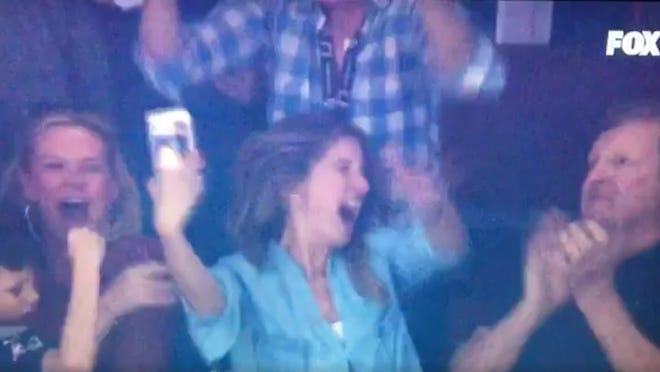 Gisele Bundchen celebrates Tom Brady's comeback win in the Super Bowl.