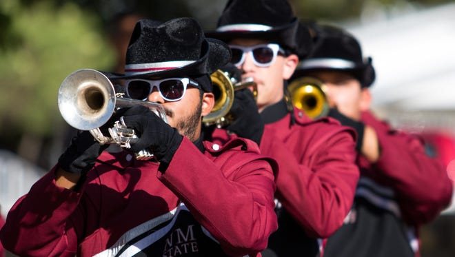 NMSU Aggie Pride band horns during the NMSU Homecoming Parade on October 28, 2017.