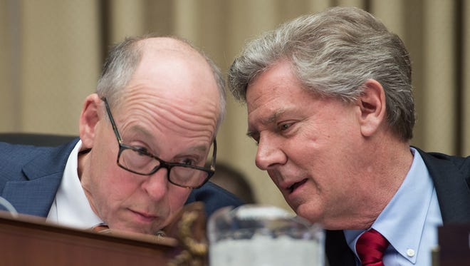 Reps. Greg Walden, R-Ore., and Frank Pallone, D-N.J., discuss the Republican proposal to replace the Affordable Care Act during a committee session.