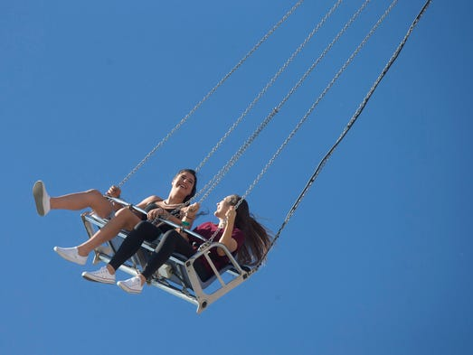 Noelle Weintraub, 14, left, and Alli Meisel, 14, ride