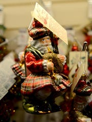"""An kilted, Scottish Santa sits in Bronner's """"Christmas"""