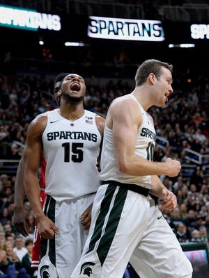 Spartans forward Matt Costello (10) and Spartans forward Marvin Clark Jr. (15) react after Costello was fouled while attempting a shot in the first half against Indiana Sunday, Feb. 14, 2016 in the Breslin Center in East Lansing.