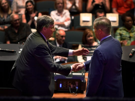 House Minority Leader Craig Fitzhugh, D-Ripley, and former Nashville Mayor Karl Dean shake hands after the Tennessee Democratic gubernatorial debate Tuesday, June 19, 2018, at Belmont University's McAfee Concert Hall in Nashville, Tenn.