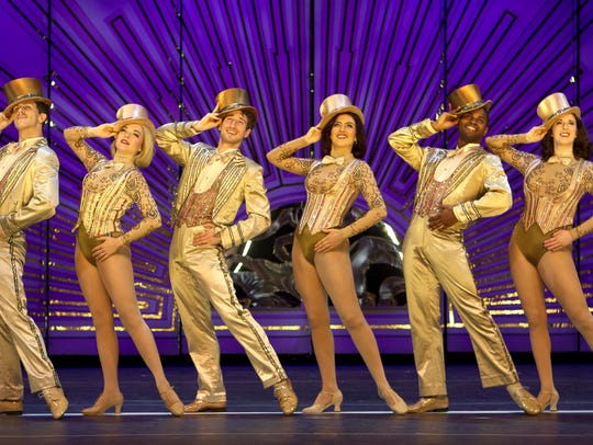 The cast of the National Tour of 'A Chorus Line' performs