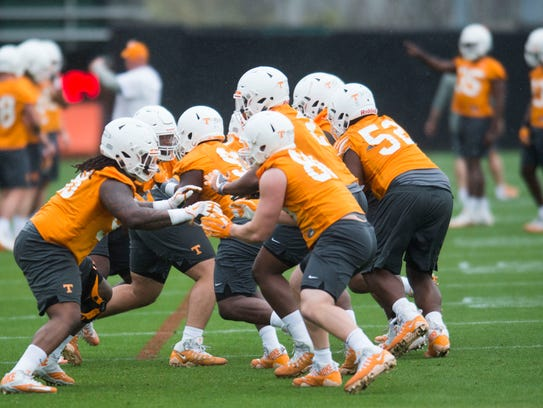 Players participate in a drill during the first Vol