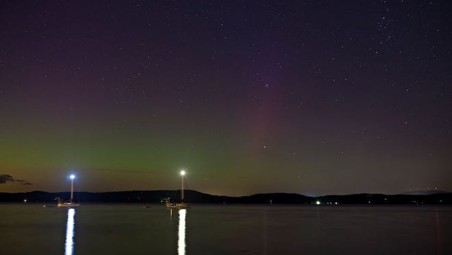 The northern lights visible over Malletts Bay in Colchester on Friday night.