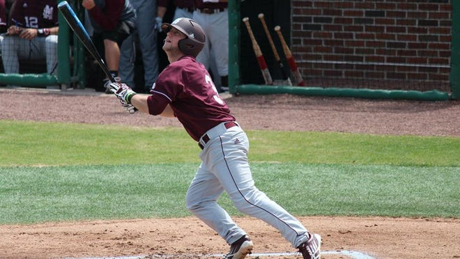 Alex Detz watches his hit during last weekend's series against Missouri. MSU swept the Tigers and moved up in this week's polls.