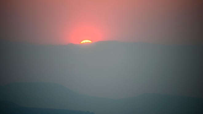 Sunset in Reno on Monday, Sept. 15, 2014, as viewed through the King Fire smoke. The photo was taken from the back deck of home near Plumb Lane and McCarran Boulevard. Submitted by Stephen Wheatcraft of Reno.