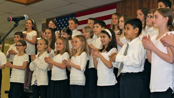A chorus from State Road Elementary School entertained visitors to Community Arts Day.