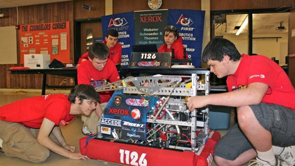 Members of the SparX robotics club from Schroeder and Thomas high schools gave demonstrations of their robot.
