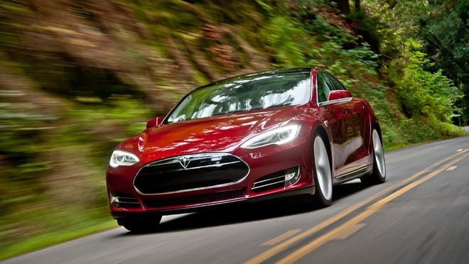 The Tesla Model S luxury sedan was Consumer Reports' top pick for best overall vehicle for 2014. But Iowa has banned test drives of the Model S over violations of state laws.