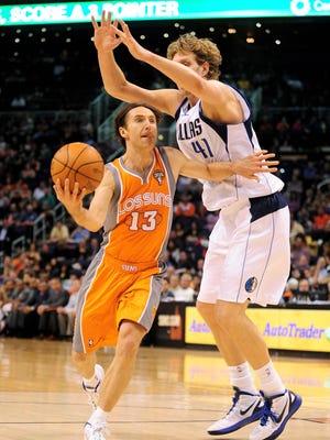 March 8, 2012; Phoenix; Phoenix Suns guard Steve Nash drives against Dallas Mavericks forward Dirk Nowitzki during the second half.