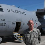 Master Sgt. Kent Pisano, a C-130 crew chief, responds to questions from a reporter following the final flight of aircraft 73-1598 at the Montana Air National Guard base at Great Falls International Airport on Sunday.